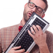 Geek in love with his keyboard — Stock Photo