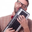 Geek in love with his keyboard - Foto Stock