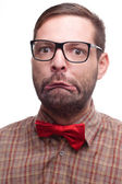 Geek making a funny face. Isolated on white background. — Stock Photo