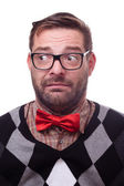 Unconfident, nervous geek. Isolated on white. — Stock Photo