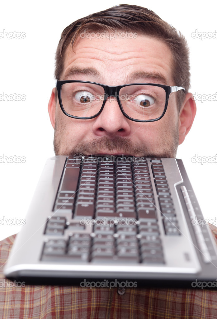 Geek biting into a keyboard   Stock Photo #7330518