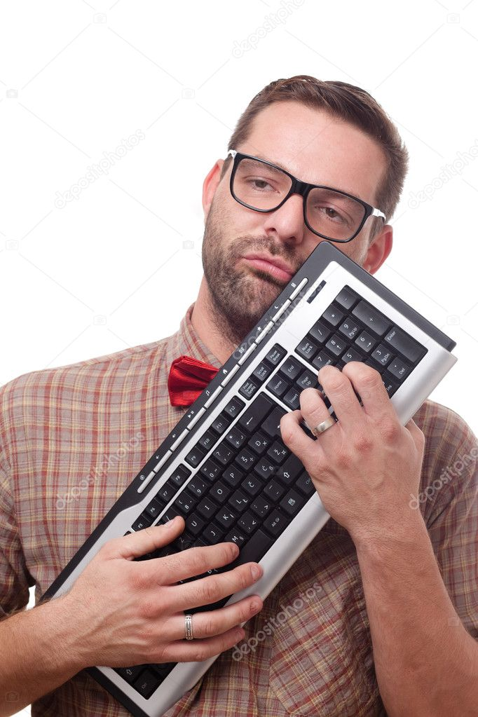 Nerd in love with his keyboard  — Stock Photo #7330525