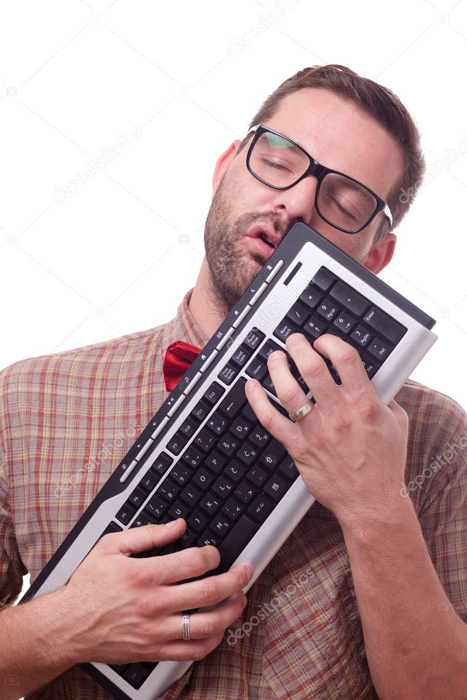 Geek in love with his keyboard  Foto de Stock   #7330529