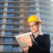 Beautiful young construction engineer/architect using tablet com — Stock Photo