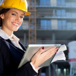 Attractive happy female construction engineer/architect with a t — Stock Photo