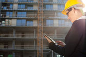 Young female construction specialist using tablet comput — Stock Photo