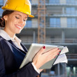 Attractive female construction specialist with tablet computer — Stok Fotoğraf #7588380