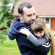 Father holds his daughter in his arms — Stock Photo