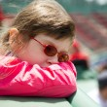 Little girl visiting a baseball park — Stock Photo #6782531