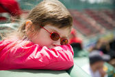 Little girl visiting a baseball park — Stok fotoğraf