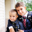 Постер, плакат: First grader boy hugs his younger brother