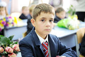 Portrait of first-grader boy sitting at his desk — Stock Photo