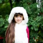 Cute little girl in fur coat under rowan tree — Stock Photo #6850577