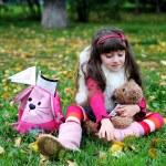 Cute little girl wearing fur coat in autumn forest — Stock Photo #6850600