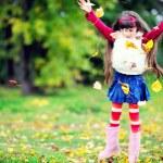 Cute little girl wearing fur coat in autumn forest — Stock Photo