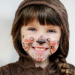 Adorable child girl with painted face — Stock Photo