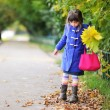 Funky little child girl in autumn atmosphere — Stock Photo #6954644