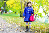Funky little child girl in autumn atmosphere — Stock Photo