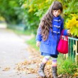 Funky little child girl in autumn atmosphere - Lizenzfreies Foto