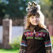 Outdoors portrait of adorable girl wearing crown — Zdjęcie stockowe #7073736