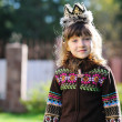 Foto de Stock  : Outdoors portrait of adorable girl wearing crown