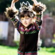 Fashionable child girl with hands over head — Stock Photo