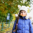 Portrait of cheerfull child girl in white hat — Stock Photo