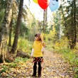 Child girl with balloons in autumn forest — Stock Photo #7156309