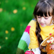 Portrait of cute child girl sitting outdoors — Stock Photo