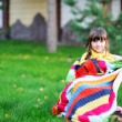 Stock Photo: Portrait of cute child girl sitting outdoors
