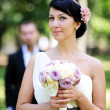 Beautiful bride posing outdoors on wedding day — Stock Photo