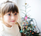 Cute child girl waiting for Christmas eve — Stock Photo