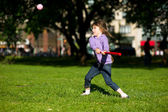Child girl playing baseball in park — Stock Photo