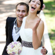 Happy bride and groom enjoying their wedding day — Stock Photo