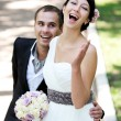 Happy bride and groom enjoying their wedding day — Stock Photo #7533871