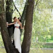 Bride and groom together in the park — Stock Photo