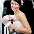 Beautiful bride posing outdoors on wedding day — Foto de Stock