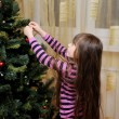 Little girl decorating the Christmas tree — Stock Photo