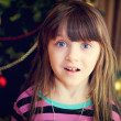 Portrait of little girl under Christmas tree — Stok fotoğraf