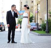 Groom kissing bride's hand — Stock Photo