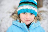 Little child girl posing outdoors in winter outfit — Stock Photo