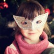 Portrait of little girl in carnival mask — Stock Photo