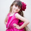 Pretty little girl in beautiful pink dress — Stock Photo