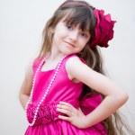 Pretty little girl in beautiful pink dress — Stock Photo