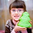 Stock Photo: Portrait of smiling child girl with gingerbread