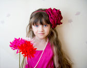 Pretty little girl in beautiful dress with flowers — Stock Photo