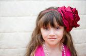 Portrait of little girl with flower headband — Stock Photo