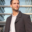 Confident businessman looking in front of a building — Stock Photo #6815235