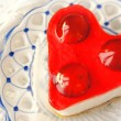 Sweet cake in heart shape — Stock Photo