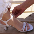 Putting Brides Shoes On — Stock Photo